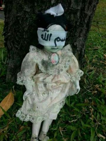 This creepy-looking figurine was apparently found resting against a tree by the side of a busy street in Singapore.