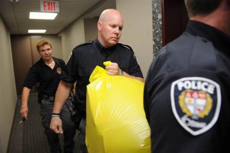 Sean Kilpatrick / The Canadian Press via AP A police officer removes a package from the Conservative party headquarters in Ottawa, Canada, on Tuesday.
